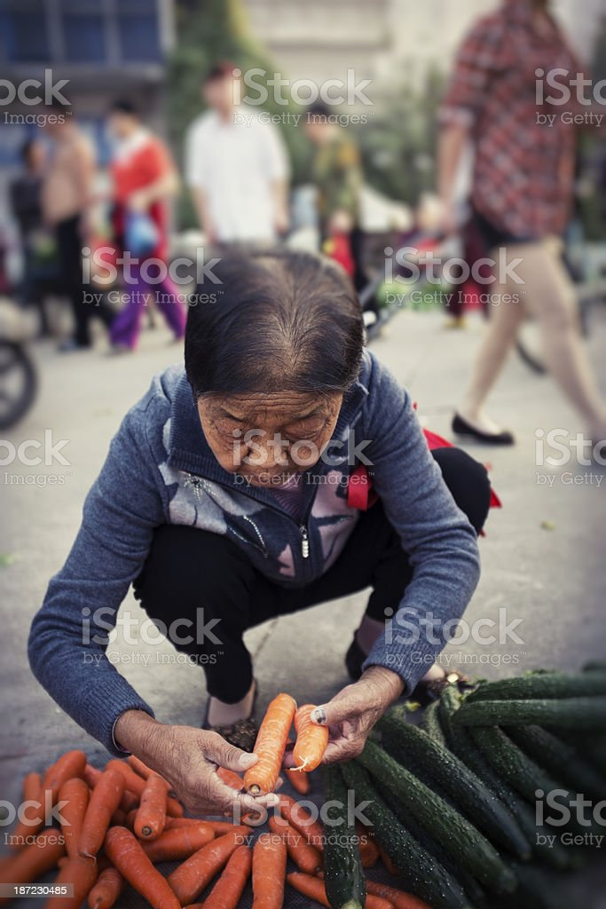 My grandmother to buy carrots royalty-free stock photo