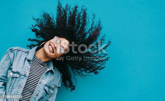 1062933270istockphoto My hair is so much fun 1189143223