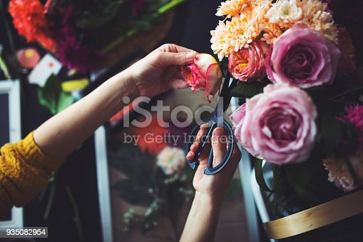 Hands that prick the flowers