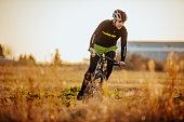 Man riding a bike in nature