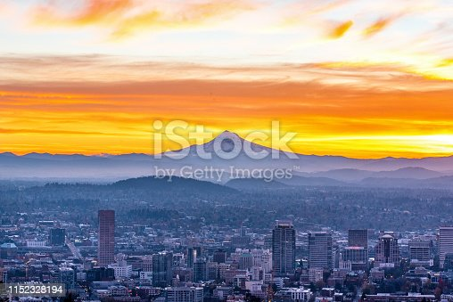 Raging sunset with Mt Hood godly looming over the city of Portland Oregon
