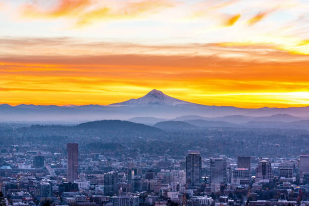My Hood Raging Sunset Portland Oregon Raging sunset with Mt Hood godly looming over the city of Portland Oregon mt hood stock pictures, royalty-free photos & images
