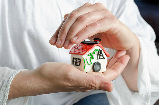 My house in my hands stock photo