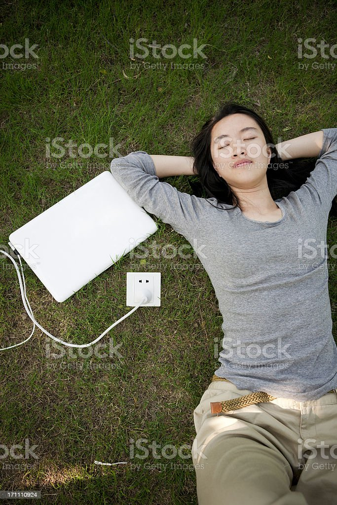 My laptop is powered by the grassland! stock photo