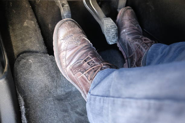 my legs driving the car my legs driving the car vehicle clutch stock pictures, royalty-free photos & images
