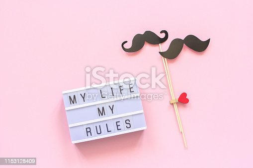 My life my rules Light box text, couple paper mustache props on pink background. Concept LGBT, Homosexuality gay love National Day Against Homophobia or International Gay Day Top view Greeting card.