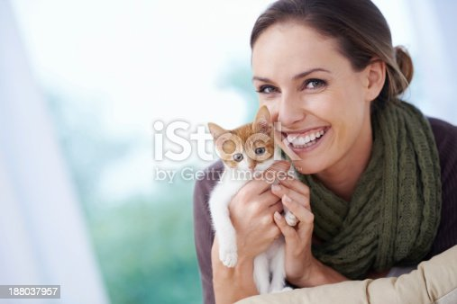 Shot of an attractive young woman holding a kitten