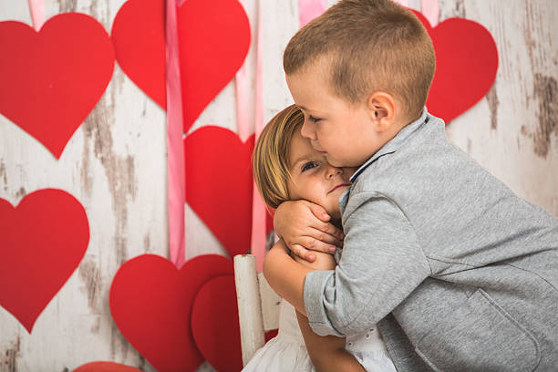 my loving little sister - little girls little boys kissing love stock photos and pictures