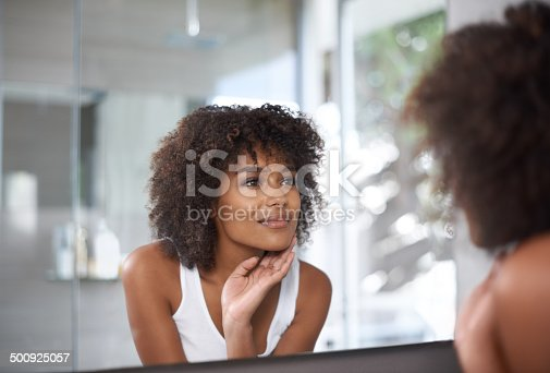 Shot of an attractive young woman looking at herself in the bathroom mirrorhttp://195.154.178.81/DATA/i_collage/pi/shoots/783545.jpg