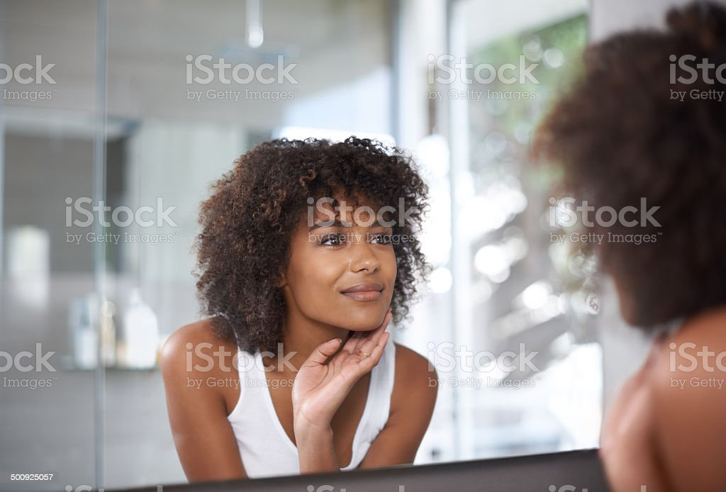 My skin just glows! stock photo
