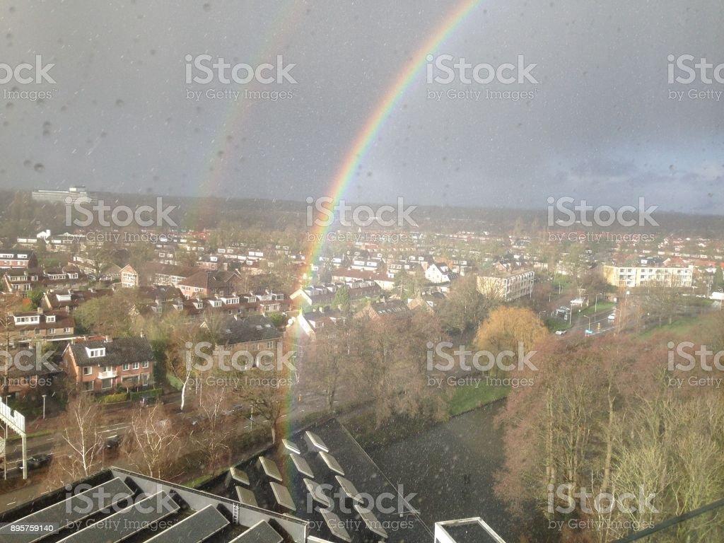 My Street Dubbele regenboog boven Amstelveen stock photo