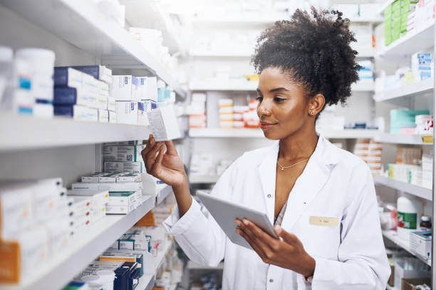 My tablet helps me with safe and accurate stock management Cropped shot of a pharmacist using a digital tablet in a chemist pharmacy stock pictures, royalty-free photos & images