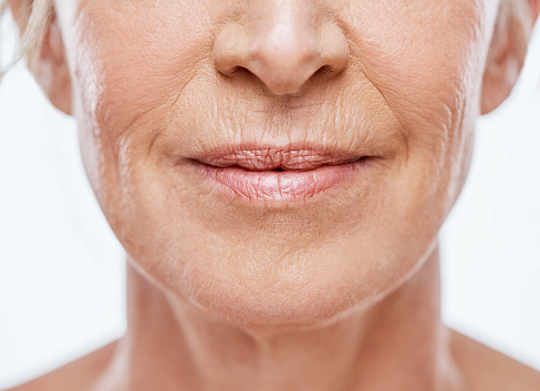 Cropped shot of a mature woman's mouth