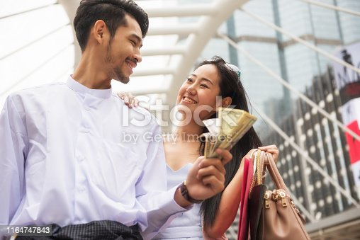 istock Myanmar couple shopping in city 1164747843