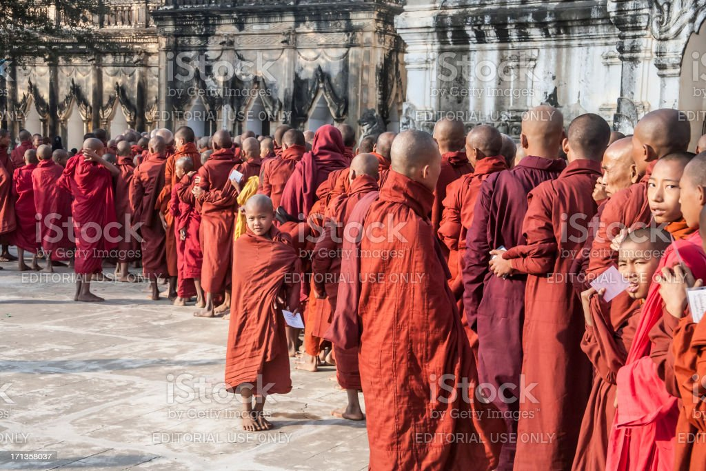 Myanmar: Line of Monks at Bagan New Year's Festival stock photo