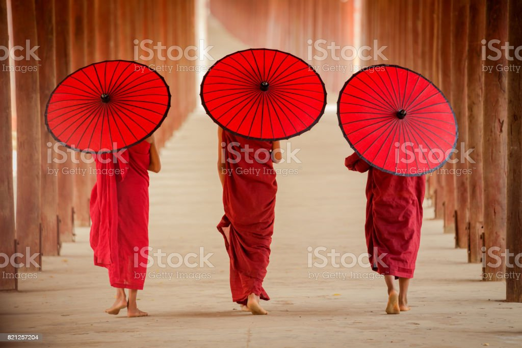 Myanmar Novice monk walking together in ancient pagoda stock photo