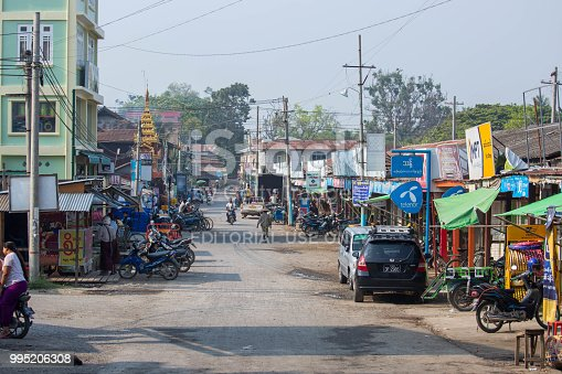 A rural town as seen from a train at a level crossing in central Myanmar.