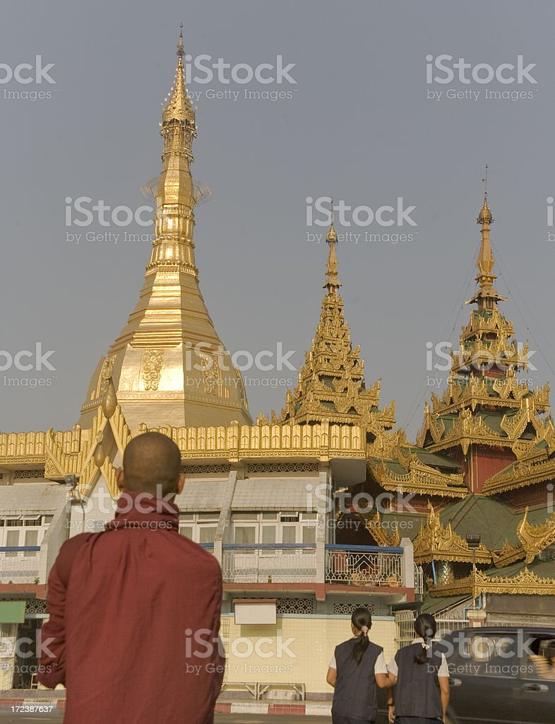 Myanmar: Sule Pagoda in Yangon with Praying Monk royalty-free stock photo