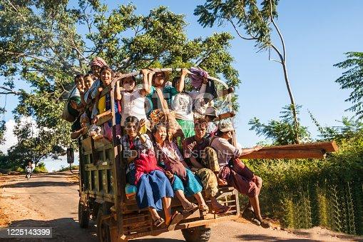 Pindaya Myanmar - November 1 2013; truck traveling on country road full of women and children.