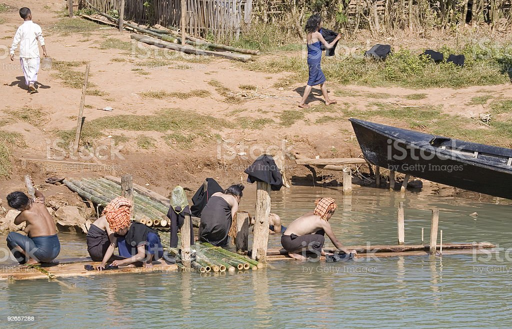 Myanmar: Women Bathing by a River Bank royalty-free stock photo