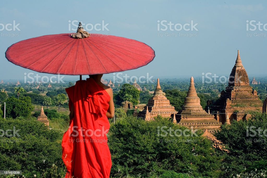Myanmar: Young Monk Overlooks Bagan Temples stock photo