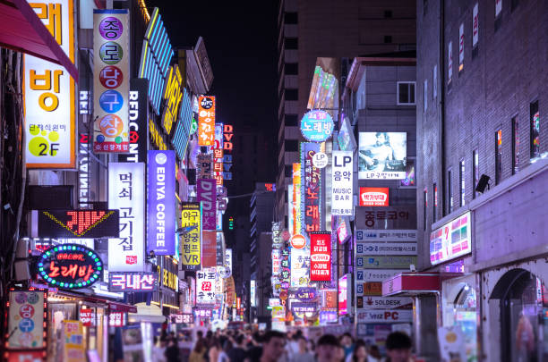 Myeongdong in Seoul at night Myeongdong in Seoul at night night market stock pictures, royalty-free photos & images