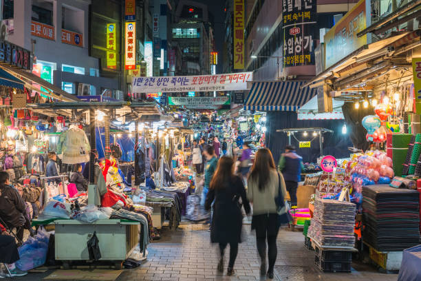 Myeong-Dong, Seoul, Korea: April 1,2016: People shopping and walking in Namdaemun street market at night, Seoul, South Korea
