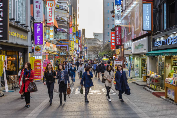 Myeong-Dong, Seoul, Korea: April 1,2016: People shopping and walking in Myeongdong street market, Seoul, South Korea stock photo