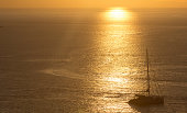 The sun sets over the Aegean Sea off Mykonos