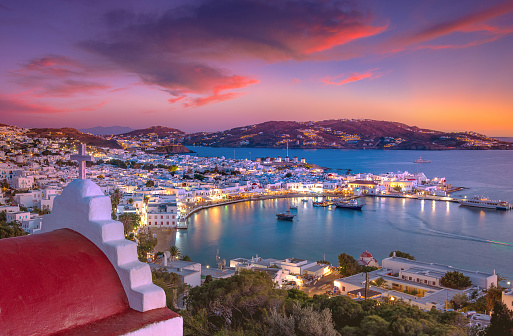 Mykonos port with boats and windmills at evening, Cyclades islands, Greece
