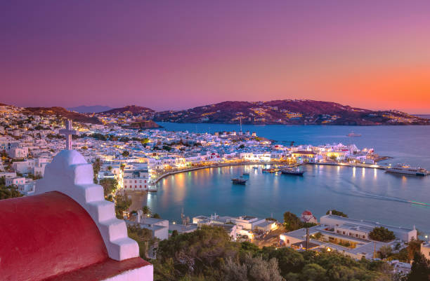 Mykonos port with boats and windmills, Cyclades islands, Greece stock photo