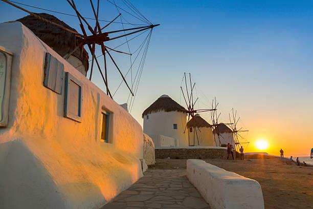 Mykonos windmills at sunset, Greece stock photo