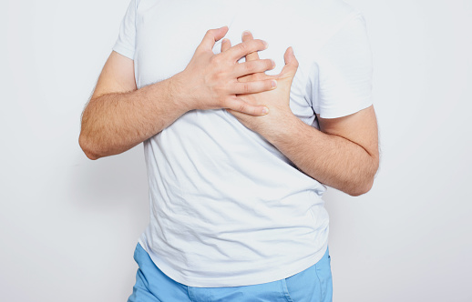 istock Myocardial infarction. The man is holding his heart, he feels strong chest pain. Heart problems, hypertension. 1167029220