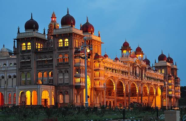 Mysore Palace in India illuminated at night stock photo