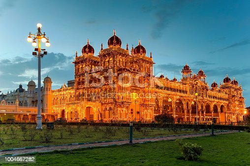 The majestic Mysore Palace known also as Ambavilas Palace against the blue hour in Mysuru, Karnataka, South India.