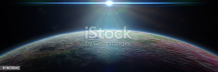 istock mysterious alien planet lit by a bright blue star 918026042