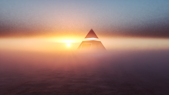 Mysterious alien pyramid in the desert at sunset.