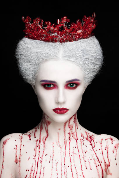 mysterious beauty portrait of snow queen covered with blood. bright luxury makeup. white demon eyes. - gothic fashion stock photos and pictures