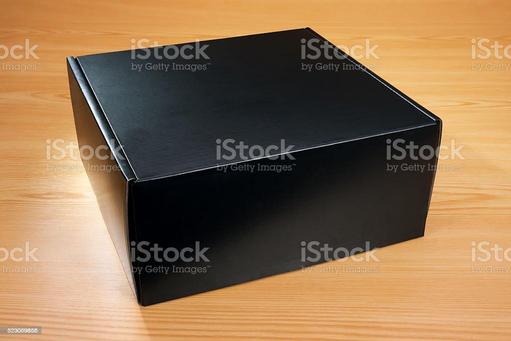 Blank black box mock up on wood backgroundBlank black box mock up on...