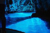 People visiting spectacular blue cave in boat, Modra Spilja, Bisevo, Croatia