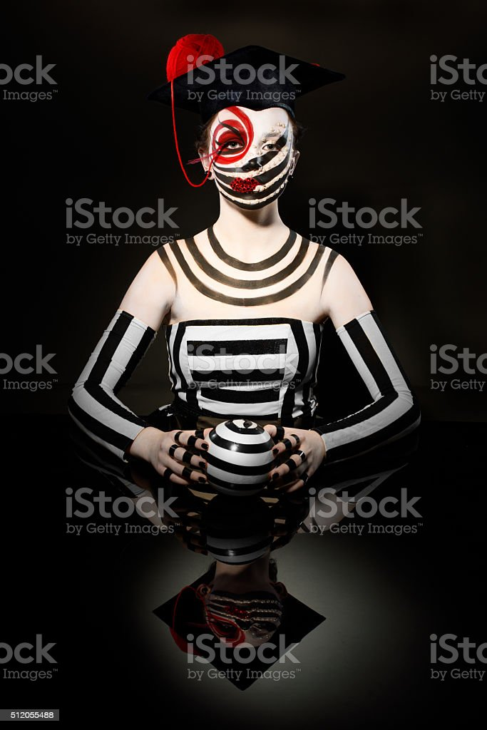 mysterious circus clown with creative make up stock photo