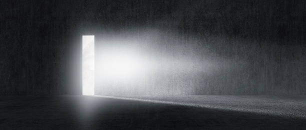 Mysterious door with glowing light stock photo