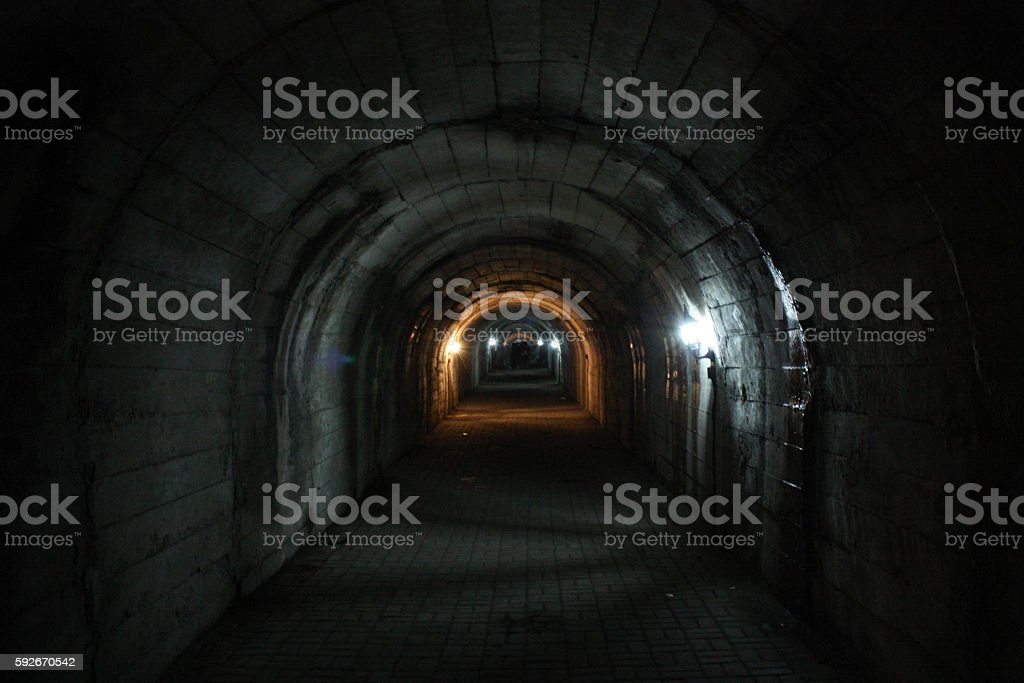 Mysterious dungeon- tunnel with walls made of stone stock photo