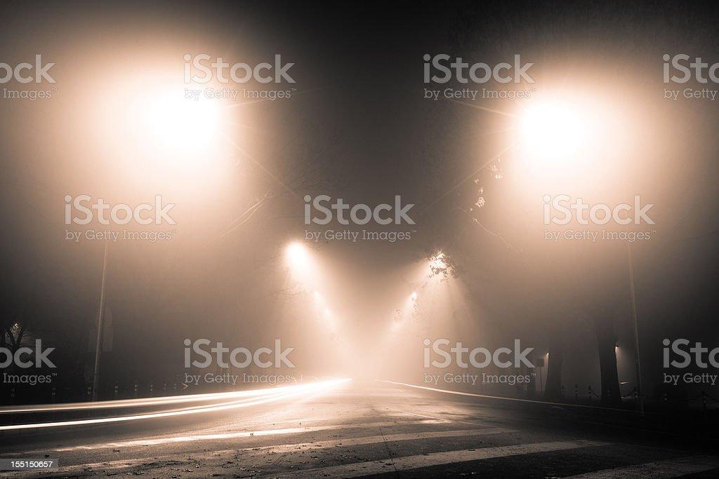 Mysterious foggy street royalty-free stock photo