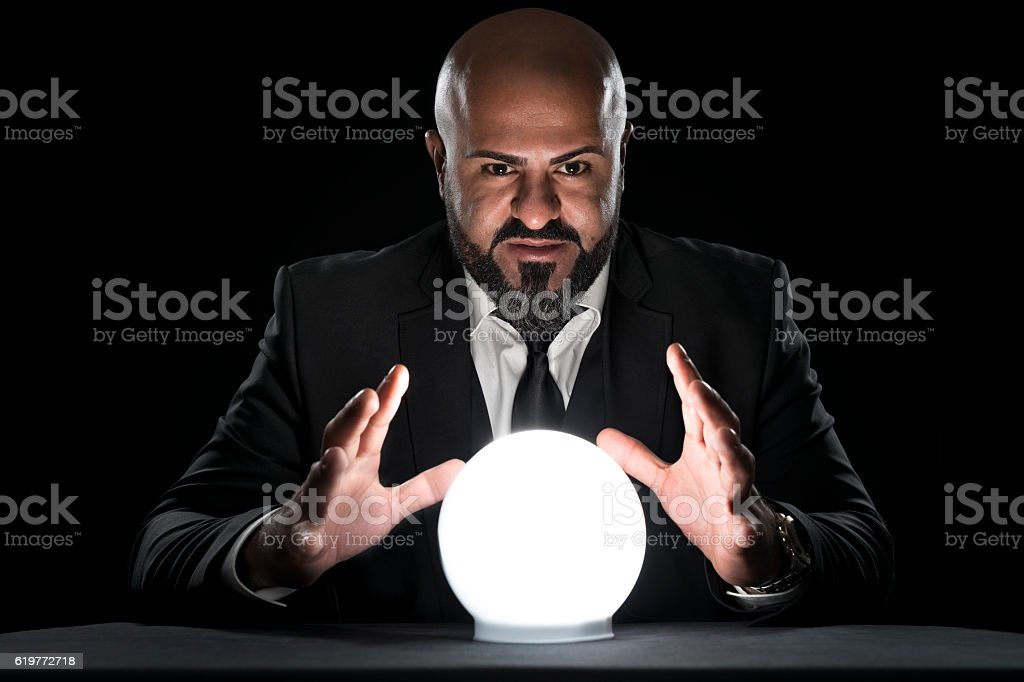 mysterious fortune teller gesturing at crystal ball - foto de stock