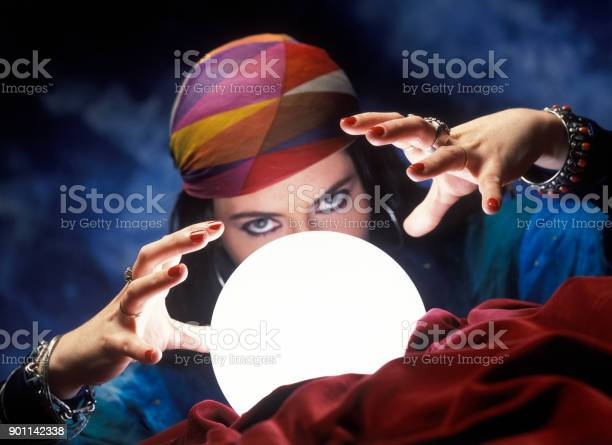 Mysterious fortune teller with glowing crystal ball picture id901142338?b=1&k=6&m=901142338&s=612x612&h=qy2ug8lkqhjuclsxg6pjm5lpvv33czhuaadm10 zu6o=