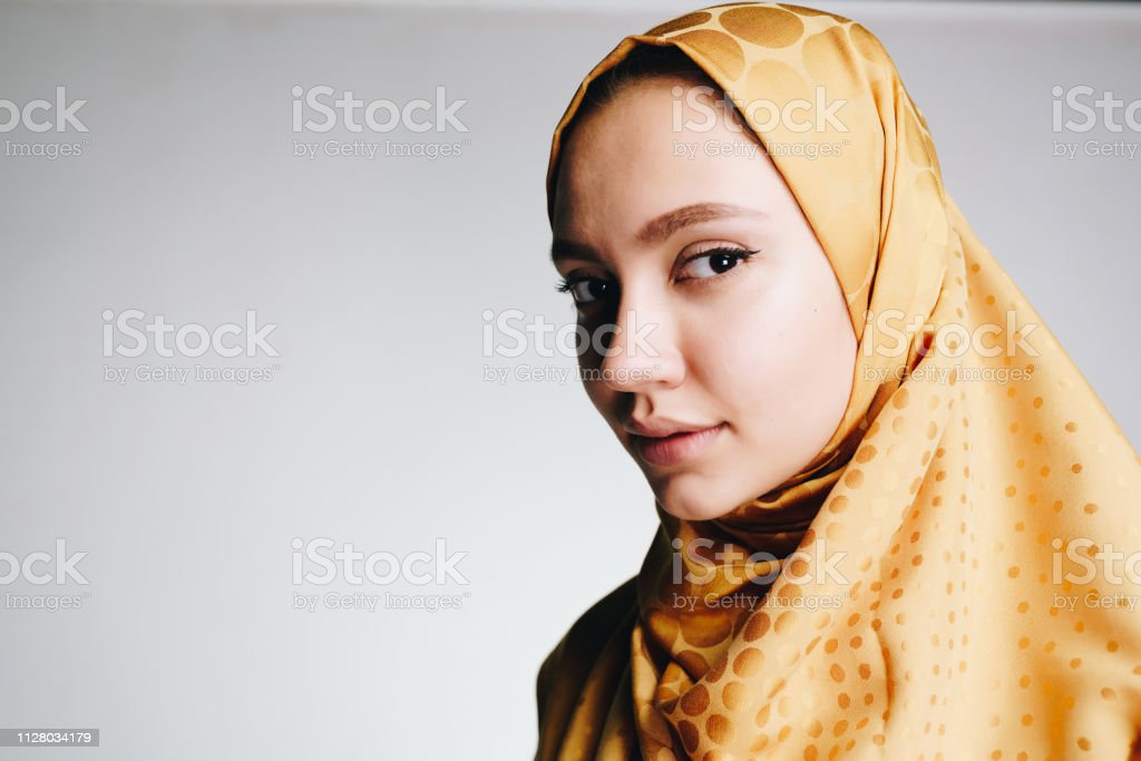 Mysterious Girl In Muslim Clothes Is Looking Calmly At The