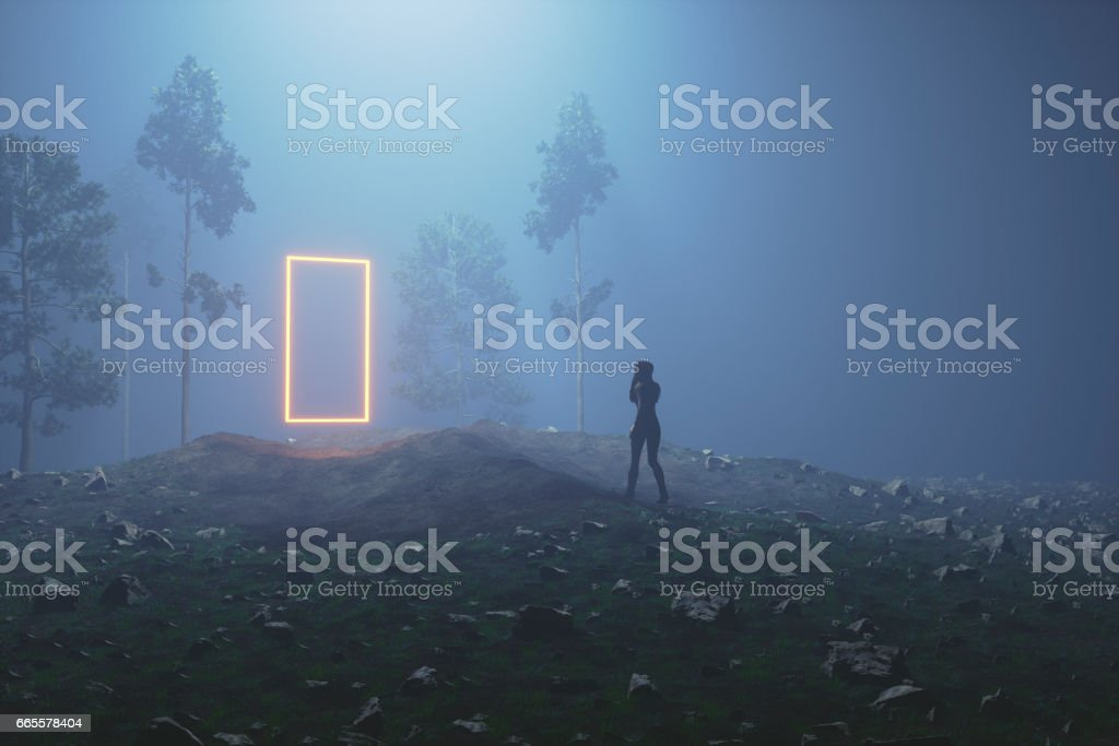 Mysterious glowing portal in the forest at night stock photo