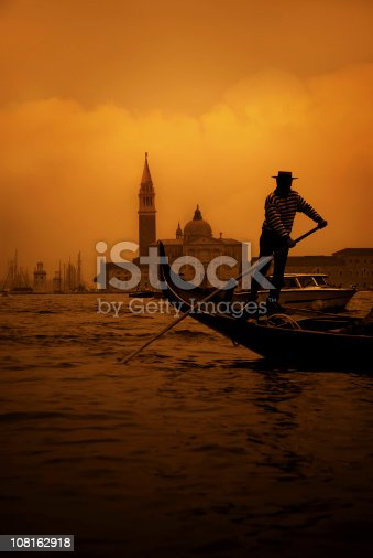 a gondolier in the grand canal with the lido palace behind