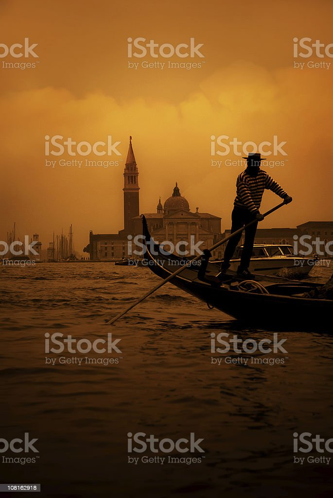 mysterious gondolier stock photo